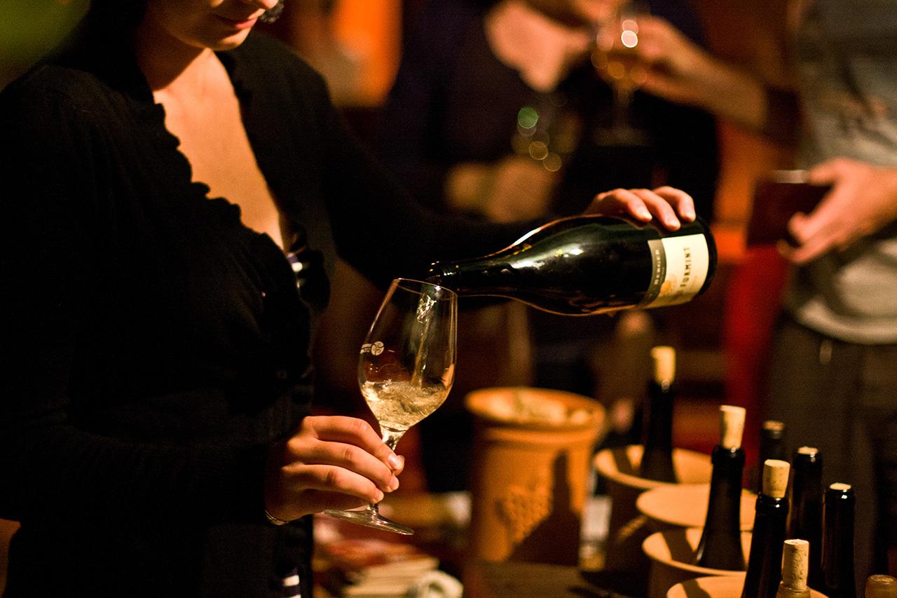 pouring wine at the Erdőbénye Bor, Mámor... Bénye festival