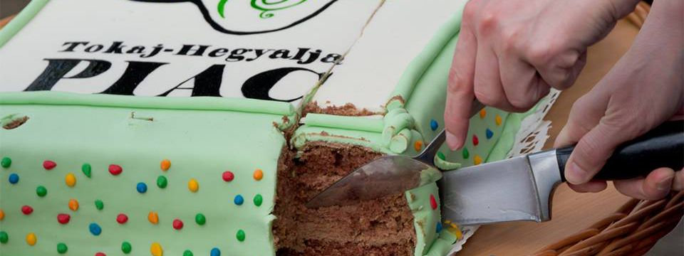 Tokaj Hegyalja piac market - photo of cutting birthday cake